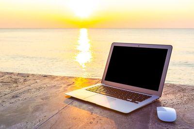 MNG summer pool laptop.jpg